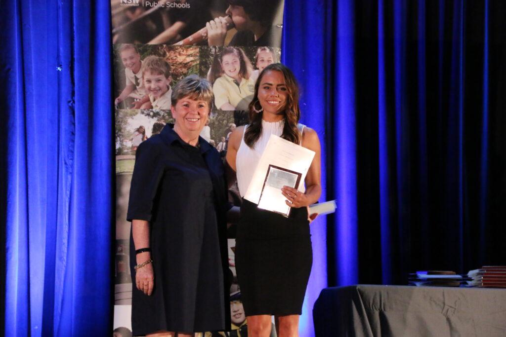 Kristen Receiving award